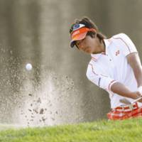 Short stay: Ryo Ishikawa blasts out of a bunker during the second round of the Transitions Championship on Friday. Ishikawa shot a 71 and missed the cut by 10 strokes. | KYODO PHOTO