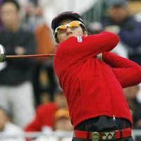Ryo Ishikawa watches his shot on Friday during the second round of the Token Homemate Cup in Kuwana, Mie Pref. | KYODO PHOTO