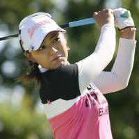 In a groove: Sakura Yokomine cards a 6-under 66 in the first round of the Munsingwear Ladies Tokai Classic on Friday at the Minami-Aichi Country Club. | KYODO PHOTO