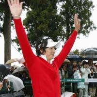 Ryo Ishikawa waves to the crowd at the Taiheiyo Club in Shizuoka Prefecture Sunday after becoming the youngest player to register 10 victories on the JGTO tour. | KYODO