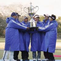 The senior men's tour hold their trophy aloft has taking the 3 Tours Championship at Hirakawa Country Club in Chiba Prefecture. | KYODO