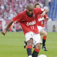 Twice as nice: Urawa Reds striker Edmilson scores the second of his two goals in the 86th minute against Consadole Sapporo in Tuesday's J. League first-division match at Saitama Stadium 2002. Reds won 4-2. | KYODO PHOTO