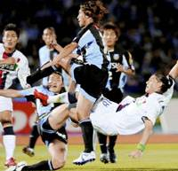 Falling: Kashima forward Marquinhos (far right) scores the first goal of the match against Frontale on 14th minute at Todoroki Stadium on Saturday. Kawasaki won 3-2. | KYODO PHOTO