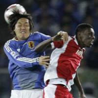 Heads up: Yasuhito Endo (left) battles Oman's Fawzi Doorbeen during Japan's 3-0 win on June 2. | AP PHOTO