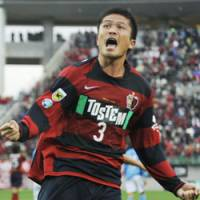 Winning shout: Antlers defender Daiki Iwamasa reacts after netting a game-winning goal in the 90th minute against Jubilo Iwata at Kashima Stadium on Saturday. Kashima won 1-0. | KYODO PHOTO