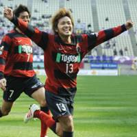 Victory run: Kashima forward Shinzo Koroki (13) reacts after he scores the match-winning goal in the 90th minute against Kyoto Sanga FC at home on Saturday. Antlers won 2-1. | KYODO PHOTO