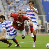 No way through: Urawa's Naohiro Takahara finds his path blocked during Reds' loss to Marinos on Sunday. | KYODO PHOTO