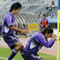 Praise be: Yosuke Kashiwagi celebrates his opening goal in Sanfrecce's 3-2 win over Yokohama F. Marinos on Saturday. | KYODO PHOTO