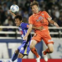 Eye on the ball: Montedio's Ryo Kobayashi (left) and S-Pulse's Frode Johnsen compete for the ball during Saturday's J. League match. Shimizu beat Yamagata 1-0. | KYODO PHOTO
