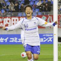 Kansai star: Gamba Osaka's Masato Yamazaki scores both goals in a 2-1 win over Kashima Antlers in the Emperor's Cup quarterfinals on Saturday. | KYODO PHOTO