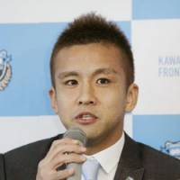 Confident veteran: Midfielder Junichi Inamoto, who has earned 74 caps for the Japan national team, tells reporters during a Friday news conference that he believes he'll be a good fit for Kawasaki Frontale, his new team. | KYODO PHOTO