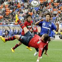 Dynamic attack: Kashima forward Marquinhos attempts a bicycle kick against Gamba Osaka in the Fuji Xerox Super Cup at National Stadium on Saturday. Antlers won 5-3 on penalties. | KYODO PHOTO