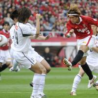 On target: Reds midfielder Hajime Hosogai scores a seventh-minute goal against Frontale on Sunday in Saitama. Urawa beat Kawaski 3-0. | KYODO PHOTO