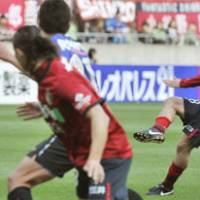 Beautiful kick: Antlers midfielder Takuya Nozawa scores a 68th-minute goal for his team in a 2-1 victory over Gamba Osaka on Saturday at Kashima Stadium. | KYODO PHOTO