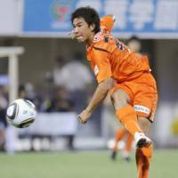 Focused: Shimizu S-Pulse forward Shinji Okazaki shoots the ball during Saturday's J. League match against Yokohama F. Marinos at Outsourcing Stadium. F. Marinos won 2-1. | KYODO PHOTO