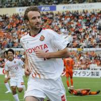 Scoring maestro: Josh Kennedy bags a pair of goals for Nagoya Grampus in the second half of a 5-1 win over Shimizu S-Pulse on Saturday. | KYODO PHOTO