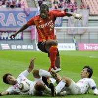 Closing in: Nagoya's Danilson Cordoba hurdles two Cerezo Osaka defenders at Toyota Stadium on Saturday. | KYODO PHOTO