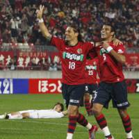 One is enough: Kashima Antlers striker Marquinhos (18) celebrates his goal in the 59th minute against first-place Nagoya Grampus on Sunday. | KYODO PHOTO
