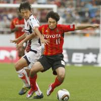 Almost there: Keiji Tamada (right) and Nagoya Grampus moved a step closer to the J. League title on Sunday. | KYODO PHOTO