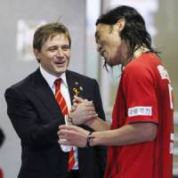 Good job: Nagoya Grampus manager Dragan Stojkovic congratulates goalscorer Takahiro Masukawa on Sunday. | KYODO PHOTO