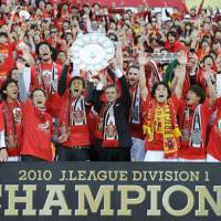 HOW SWEET IT IS: Nagoya Grampus players, staff members and fans celebrate the team's J. League title-clinching victory over Shonan Bellmare on Saturday. It was Grampus' first J. League title. | KYODO PHOTO