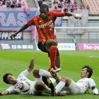 Top class: Danilson Cordoba (center) and Nagoya Grampus look poised to repeat as J. League champions. | KYODO PHOTO