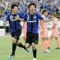 Game on: Gamba's Sota Nakazawa celebrates scoring in his side's 5-3 win over Sanfrecce on Sunday. | KYODO