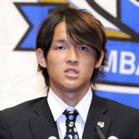 Fly boy: Takashi Usami speaks at a news conference to announce his loan move to Bayern Munich on Monday. | KYODO PHOTO