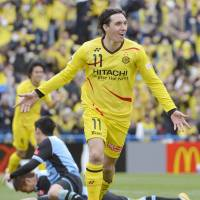 New hero: Kashiwa striker Cleo celebrates the first of his two goals in Reysol's 3-1 win over Kawasaki Frontale on Sunday. | KYODO