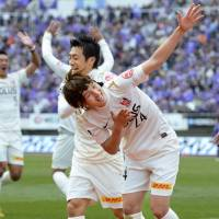 Take a bow: Urawa Reds forward Genki Haraguchi (24) celebrates his goal in Saturday's 2-1 J. League season-opening win over champions Sanfrecce Hiroshima. | KYODO