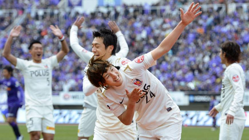 Take a bow: Urawa Reds forward Genki Haraguchi (24) celebrates his goal in Saturday's 2-1 J. League season-opening win over champions Sanfrecce Hiroshima.