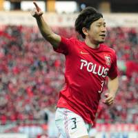 Signature moment: Tomoya Ugajin of the Urawa Reds celebrates his 54th-minute goal against Nagoya Grampus on Saturday in Saitama. Reds defeated Grampus 1-0. | KYODO