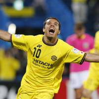 Double trouble: Reysol's Leandro Domingues celebrates after the second of his two goals against the Mariners on Wednesday in Kashiwa, Chiba Prefecture. Reysol won 3-1. | KYODO