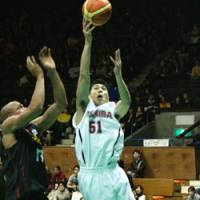 Toshiba guard Takuya Kita scores a layup past Alvark forward Charles O'Bannon during the semifinals of the All-Japan Basketball Championships on Saturday at Yoyogi National Stadium Annex. With an 86-58 win over the Brave Thunders, defending champion Toyota Motors advanced to Monday's final. | KAZ NAGATSUKA PHOTO