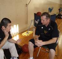 Meeting time: Ryukyu Golden Kings coach Dai Oketani (left) and assistant coach Keith Richardson talk about the team's next opponent, the Takamatsu Five Arrows, earlier this week in Okinawa. Ryukyu (6-0) is the bj-league's lone unbeaten team. | RYUKYU GOLDEN KINGS
