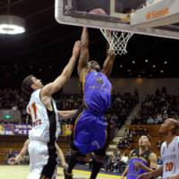 Air time: John Humphrey of the Tokyo Apache rams home a dunk during his team's 78-69 loss to the Osaka Evessa at Yoyogi National Gymnasium on Wednesday. | YOSHIAKI MIURA PHOTO