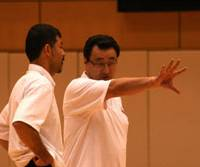 Leading the way: Japan national basketball team interim head coach Osamu Kuraishi (right) speaks with assistant coach Masaki Goto during practice at the National Training Center on Monday. | KAZ NAGATSUKA PHOTO