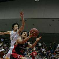 Solid impact: Rookie guard Hirohisa Takada (33) has helped the Western Conference-leading Osaka Evessa win 18 of their last 22 games. | OSAKA EVESSA / bj-league