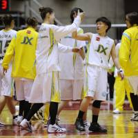 Flower power: The JX Sunflowers celebrate their win over the Fujitsu RedWave on Sunday. | KYODO PHOTO