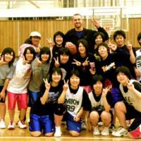 Positive role model: Shiga Lakestars center Ray Schafer (back row) coached students throughout the week during his church's visit to Iwaki, Fukushima Prefecture, to assist in the region's recovery efforts from the devastating March 11 earthquake. | RAY SCHAFER PHOTO