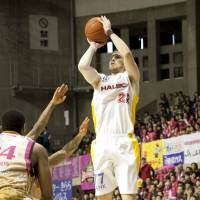 Down to the wire: Sendai's Dan Fitzgerald puts up a jumper against Akita in the opening game of their Eastern Conference first-round playoff series on Saturday. | DOMINIKA FITZGERALD