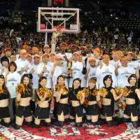 Team spirit: The Ryukyu Golden Kings celebrate after beating the Hamamatsu Higashimikawa Phoenix 89-73 to win the bj-league title on Sunday. | YOSHIAKI MIURA