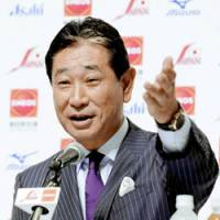 Ready to roll: Senichi Hoshino gestures during the press conference announcing the Japanese Olympic baseball team on Thursday. | KYODO PHOTO