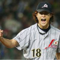 Lofty aspirations: Right-handed pitcher Yu Darvish (below), who plays for the Hokkaido Nipon Ham Fighters, hopes to help 'Hoshino Japan' celebrate an Olympic title in Beijing later this month. | KYODO PHOTO
