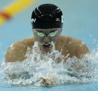 Full steam ahead: Kosuke Kitajima swims to victory in his 100-meter breaststroke semifinal at the Water Cube in Beijing on Sunday morning. Kitajima won in a time of 59.55 seconds to earn in a place in Monday's final. | AP PHOTO