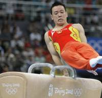 Spin doctor: China's Huang Xu performs on the pommel horse during the men's team final in Beijing on Tuesday. Japan took silver behind the hosts in the event. | AP PHOTO