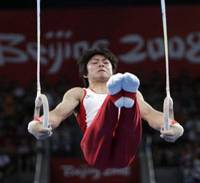 Hold on: Kohei Uchimura performs on the rings during the men's gymnastics individual all-around finals, in which he won the silver medal, at the Beijing Olympics on Thursday. | AP PHOTO
