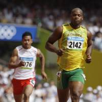 Former record-holder: Jamaica's Asafa Powell runs in the men's 100-meter heat at the Beijing Olympics on Friday. | AP PHOTO