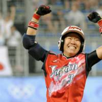 Walking off happy: Rei Nishiyama celebrates after her 12th-inning sayonara single lifted Japan past Australia 4-3 on Wednesday in Beijing. Japan will play the U.S. for the gold medal on Thursday. | KYODO PHOTO