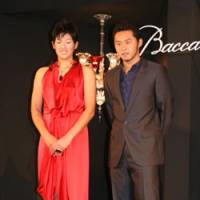 Happy moment: Olympians Yukiko Ueno (left) and Kosuke Kitajima, recipients of the 2008 Baccarat Athletes of the Year Award, enjoy the spotlight during a special reception on Tuesday. | KAZ NAGATSUKA
